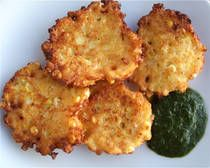 Corn Fritters... I love these. I've made them with 1 can of whole kernel corn and 1 can of cream style corn too. Taste excellent. I don't serve them with any sauce. Just salt.
