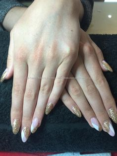 Acrylic nails, gold glitter with pink and white design.