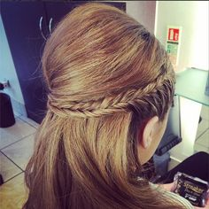 A pompadour paired with a sleek, wraparound fishtail braid mixes vintage class with modern beauty in a snap.