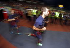 Javier Mascherano and Andres Iniesta of Barcelona FC enters the field during the friendly match between FC Barcelona and Malaysia at Bukit Jalil National Stadium on August 10, 2013 in Kuala Lumpur, Malaysia.