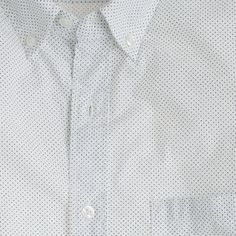This is the shirt every guy needs in his arsenal, in a classic pattern. It's crisply tailored and exceptionally soft, thanks to our top-secret multistep wash process. (If we told you what it was, it wouldn't be a secret. Sorry.) The result? A shirt that feels like it's been through an adventure or two, right out of the box. <ul><li>Slim fit, cut more narrowly through the body and sleeves.</li><li>Cotton.</li><li>Button-down collar.</li><li>Machine wash.</li><li>Import.</li></ul>