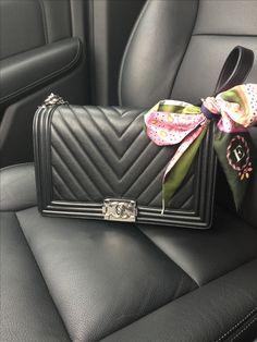 Black is beautiful. This beautiful Chanel Boy in back Chevron is my passenger today. Dressed up with a Dior Twilly.