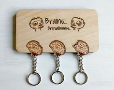 Hey, I found this really awesome Etsy listing at https://www.etsy.com/ca/listing/496751696/laser-cut-zombies-and-brains-wall-key