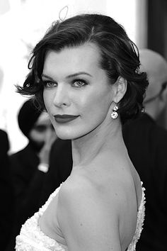 Milla Jovovich looks exactly like my grandma...(when she was little) she was so beautiful!