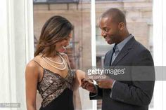 Image from http://cache4.asset-cache.net/gc/75461666-man-putting-engagement-ring-on-womans-finger-gettyimages.jpg?v=1&c=IWSAsset&k=2&d=TLmO1DuwAdllc4fHQRMfPTy2a6P8lL2CiiCrtL6u3hVZJCBGoz2UfPipwUhC4L8v.