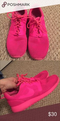 Nike Rousse hot pink Size 7 run larger Hot pink tennis shoes, barely worn bc they are too big for me. Size 7 but run about an inch larger so closer to a 7.5 Nike Shoes Athletic Shoes