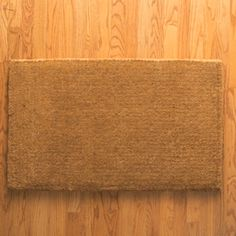 Click on the image to see this Quick Christmas Craft Idea in motion: Christmas Tree Doormat. All you need is a coir doormat, some painter's tape, green paint and brown paint. See more Quick Christmas Craft Ideas on The Home Depot Blog.