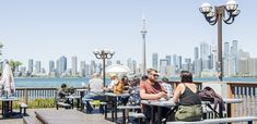 This two-tiered restaurant has patios on its main and upper floor, offering one of the best views of the downtown Toronto skyline from across the water on Centre Island. Toronto Skyline, Downtown Toronto, New York Skyline, Toronto Island, Canada Travel, Nice View, Outdoor Spaces, The Best, The Neighbourhood