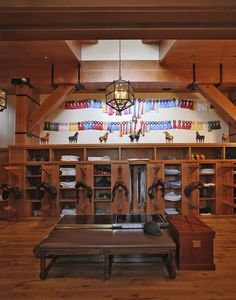 Beechwood Stables AMAZING tack room with display of ribbons and model horses
