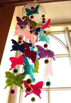 Pinner says...DIY: felt butterfly mobile tutorial. Dont miss the butterfly template download in the very first paragraph. Would be adorable for a childs room in colors that match your decor...or how about a porch?