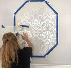 DIY painted damask accent wall makeover ideas on a budget using easy to use wall stencil patterns from Cutting Edge Stencils