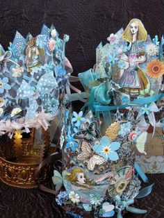 alice in wonderland paper crowns embellished with paper flower,butterlies,ribbon and crepe paper. These are incredible! Made by by leola