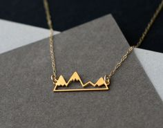 little golden mountain range necklace by WildThingStudio on Etsy