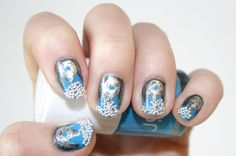 http://www.fashionmagazine.com/blogs/beauty/2012/03/28/nail-corner-we-do-effies-over-the-top-caviar-manicure-from-the-hunger-games/attachment/mar12-look2/
