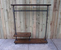 This is our Louisiana clothing rack. This is an original Vintage Steel and Wood design. This rack features a wide base, a top shelf and a mid