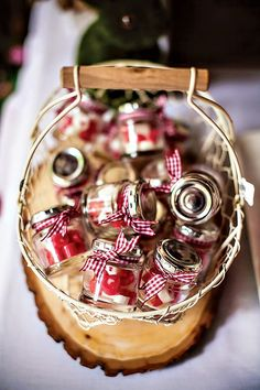 Ribbon tied jars of sweeties as party favours