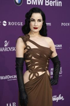 Dita Von Teese vamps in Gaultier  15 Gothic Red Carpet Looks #hair #style