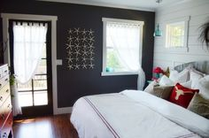 Loving the wall color, and the plank wall  After of Master Bedroom Makeover from Farmhouse38