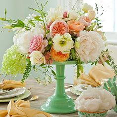 Elevate Your Flowers | For lush arrangements that impress, place flowers on footed dessert stands. To make, place a block of florist foam in a large, shallow bowl that has a slightly smaller circumference than the stand. Add flowers to create a soft dome shape, keeping some stems longer for natural asymmetry.