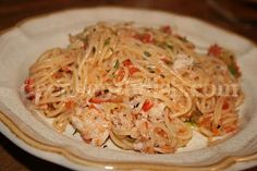 Angel Hair Pasta w/ Crab -  lump crabmeat, fresh tomatoes and fresh basil, butter and olive oil. Can use other meats or without any meat at all.