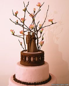 In Bermuda, couples top their wedding cakes with tiny saplings, which they plant to grow as their marriages do. The flowering quince branches used on the topper were painted with chocolate (choose pesticide-free foliage).  One of the few cake toppers I actually like.