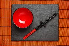 Two chopsticks and red plate on black stone background with copy by dziewul  IFTTT 500px