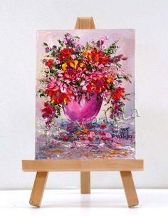 Painted after Monet impressionistic style, highly textured, which make the flowers look almost real.  Beautiful Bouquet of mixed floral arrangement. High textured, where the flowers really stand out.  This adds dimension to the painting.  The painting includes the stand, and can be placed anywhere.  It is also a great original gift ,suitable for any occasion.  I use top quality oils made by Winsor And Newton. They are light fast and keep their brilliancy.  All art is shipped priority mail…