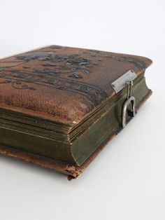 Antique Leather-Bound Photo Album With Music Box- 1900s. $140.00, via Etsy.