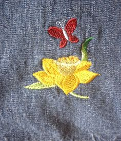 My first attempt at machine embroidery on a pair of jeans.  Thanks to Embroidery Library (emblibrary.com) for having designs and instruction at their website.