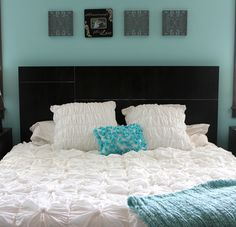 Something like that above the headboard (canvas wedding picture then 3 identical shaped artwork to the sides)