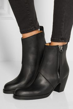 Stacked wooden heel measures approximately 80mm/ 3 inches Black leather Pull tab, round toe Zip fastening along side with tasseled pull