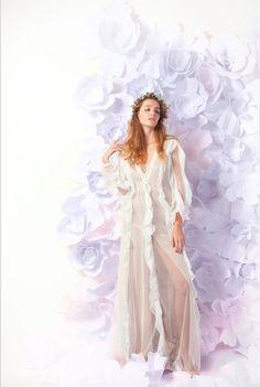This dress was ruined by a bad stylist, silk chiffon ruffles on spot mesh