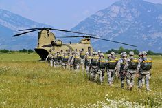 U.S. Army paratroopers load up into a CH-47 Chinook helicopter before a joint parachute training jump near the city of Pordenone in northeast Italy, July 16, 2013. Paratroopers from the 173rd Airborne Brigade Combat Team participated in a joint parachute training jump with CH-47 Chinook aircraft from the 12th Combat Aviation Brigade. Photo by Barbara Romano
