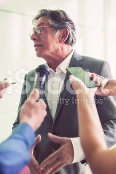 Journalists questioning a mature businessman royalty-free stock photo