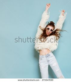 studio portrait of cheerful fashion hipster girl going crazy making funny face…