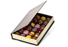 Hugo & Victor Chocolate | 24 semi-spheres infused with seasonal flavors in their Writer's notebook