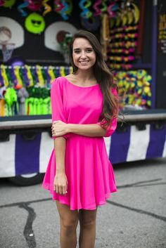This fun and flirty fuchsia dress is perfect for any summer occasion! The back details are EVERYTHING!