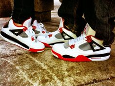 Air Jordan's fire red 4s him and hers  My kicks ;)