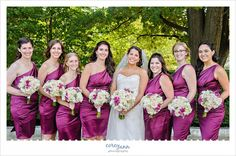 bride and bridesmaids in short satin purple one shoulder bridesmaid dresses with orchid bouquets at @clemuseumart