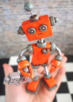 Robot Sculpture Orange Olie Rustic Bot with Robot Doll MADE TO ORDER - Clay, Wire, Paint on Etsy, $50.00