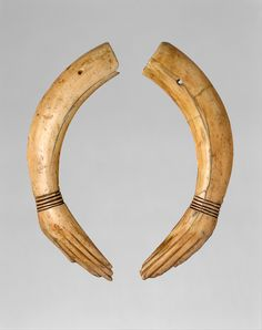 These clappers in the form of human hands were carved from a single hippopotamus tusk that was split in half. Such percussion instruments were used to keep time during dances or as part of a musical ensemble. These examples, however, were found in a miniature coffin at Amarna and seem to have been part of an offering. Reign of Akhenaten, ca. 1353–1336 B.C.