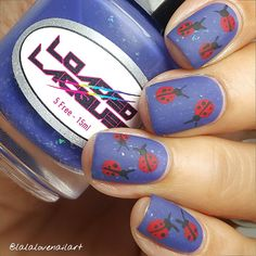 Tutorial for matte ladybugs on purple nails by @lalalovenailart!