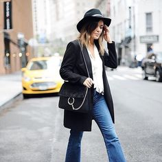 Style MBA nails all the Fall essentials here: a wool fedora, a statement bag, flared jeans, and an oversize black blazer we're obsessed with.