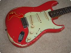 Fender Stratocaster 1962 in Fiesta Red this guitar we believed to have been owned by Chris Rea.