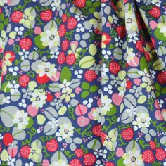 Strawberry Fields Cotton Lawn fabric with pink and red strawberries, white daisy flowers and green leaves on an airforce blue background. Lovely soft and silky lawn.
