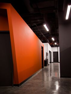 A black ceiling with white and orange walls makes a nice combo.