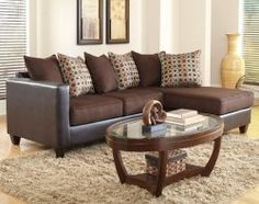 Neutrals can still make a bold statement, especially with fun accent pillows like the ones on the Fitby Julip sectional.