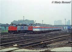 Lots of early Amtrak power including hand-me-down E8s and E9s, along with its first newly purchased diesels, SDP40Fs, are seen here at the terminal in Chicago on an overcast June 16, 1977.