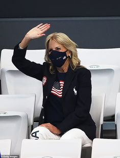 Athletes on U.S. swimming team chant 'Dr. Biden' for First Lady as she watches the Olympics Saturday | Daily Mail Online Team Chants, Cheers And Chants, Jill Biden, Swim Team, Olympians, Kicks, Swimming, Mail Online, Lady