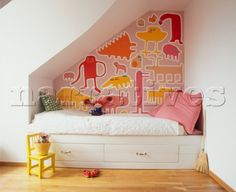 Light and stylish childs bedroom with built in bed and multicoloured animal mural on wall